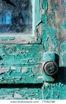 stock-photo-paint-peeling-from-wooden-door-is-77582788